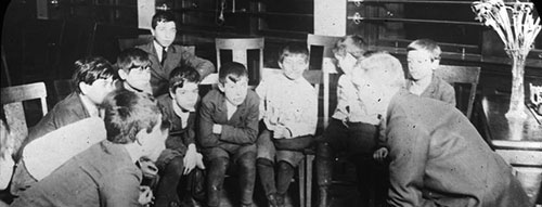 Young boys listening to a story