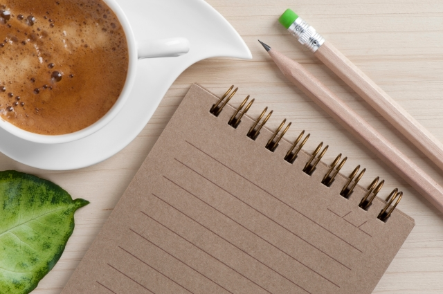 notebook, pencils, coffee
